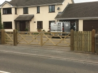 Pair of 5 bar gates and an extra pedestrian gate on sloped ground in Templeton