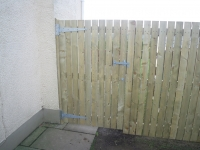 Picket fencing with small gaps, with wide matching gate