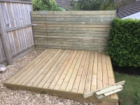 Small decking and fence with secret door in Saundersfoot