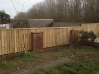 Feather Edge Fencing clad onto wall