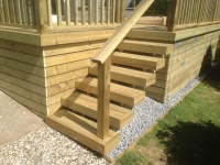 Decking with boxed-in sides and doors