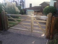 uneven split pair of 5 bar gates with smaller pedestrian gate in St Florence