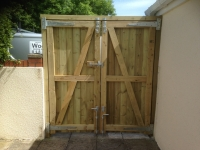 Tall Solid Gates with header bar in Carmarthen