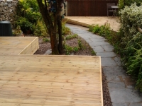 decking with enclosed sides and added skirting against the wall