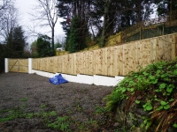 Feather edge (or closed board) fencing on top of a wall