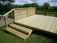 Decking with steps and alternative style of fence on the side