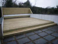 Decking with special smooth profile deck boards, Includes a floating bench, and fencing to rear