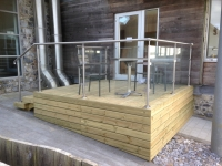 Garden decking, boxed in underneath including Stainless steel and glass balustrade