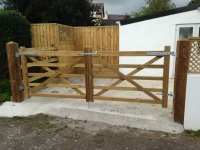 Pair of field gates and feather edge fencing in Penally