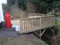 Raised decking on Wiseman's Bridge Inn Caravan Park