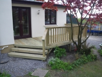 This decking includes diagonal steps to go down to the garden.