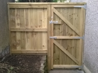 Garden Gate (Or Door) made from feather edge boards. The ironmongery is heavy duty, weatherproof and matching in colour.