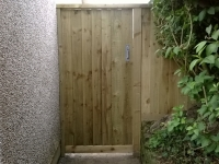Garden Gate (Or Door) made from feather edge boards. The ironmongery is heavy duty, weatherproof and matching in colour.Garden Gate (Or Door) made from feather edge boards. The ironmongery is heavy duty, weatherproof and matching in colour.