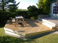 Decking with angled corner and curved back edge. Includes underneath cladding