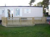 New patio style caravan decking with smooth boards and undercladding
