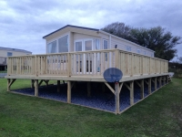 Caravan Decking with smooth boards, steps, and access ramp