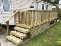 Caravan decking with storage at Amroth Bay Holidays