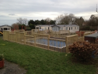 Balustrade fencing around Swimming Pool. Castellated (like a castle) on Amroth Bay Holiday Park