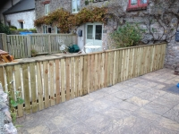 picket fencing and hidden gate