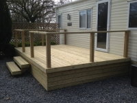 Caravan Decking with simple hand rail and boxed in underneath