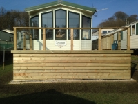 Decking with glass panels in Amroth Castle Caravan Park