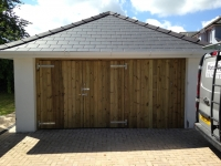 Tongue & Groove garage doors and wall in Tenby