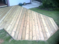 ground level decking flush with lawn with diagonal boards