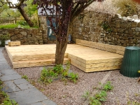 2 decking with enclosed sides and added skirting against the wall