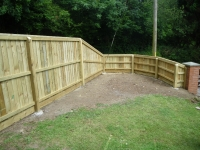4ft feather edge fencing with a turn transition into 6ft featheredge